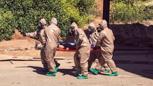 Turkish experts carry a victim of the alleged gas attacks in Syria.