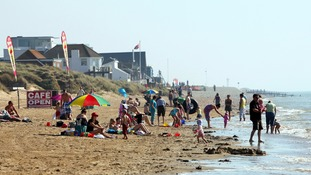The sandy East Sussex beach becomes a popular spot for swimmers in the summer months.