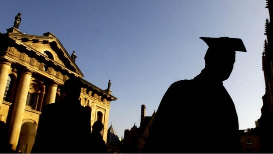 File photo of graduates queue in the quadrangle of the Sheldonian Theatre in Oxford