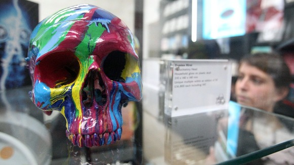 Damien Hirst replica plastic skulls for sale in the gift shop at the Tate Modern.