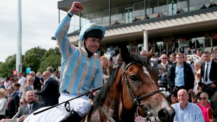 Jockey Tom Queally celebrates on Higher Power after winning the Stobart Rail Northumberland Plate