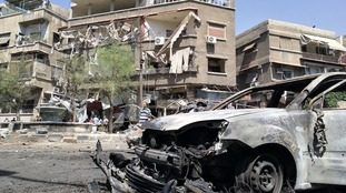The burned-out car of a suicide bomber who detonated the vehicle in central Damascus.