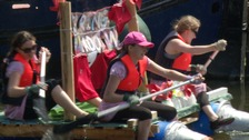 Staying afloat on a home-made raft for Aquafest in Ely.