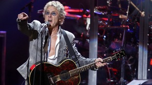 "Roger Daltrey of The Who performs during the ""12-12-12"" benefit concert"