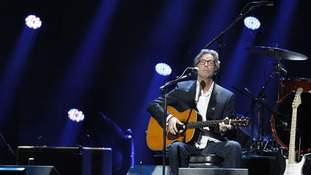 "Eric Clapton performs during the ""12-12-12"" benefit concert"