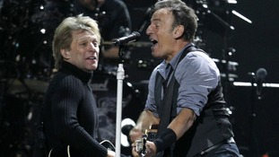"Jon Bon Jovi and Bruce Springsteen perform during ""12-12-12"" benefit concert"