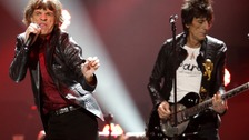 "Mick Jagger and Ron Wood of the Rolling Stones perform during the ""12-12-12"" benefit concert"