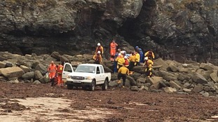 Coastguard rescues casualty who falls 15ft from cliff into narrow cave