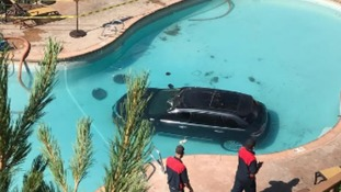 Car crashes into swimming pool after 'driver hits wrong pedal'