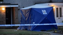 A forensic tent was put up outside a house