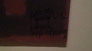 Black writing appeared on the work by Mark Rothko