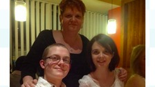 Dominic with his sister and mother