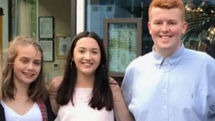 Evie (left) was reunited with Saxon Miller and Johnny McGowan, both from Bolton (centre of photo)