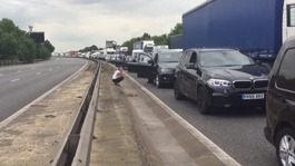 Four-vehicle crash closes M11
