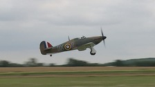 A restored Hawker Hurricane takes to the skies 77 years after crash landing at Dunkirk.