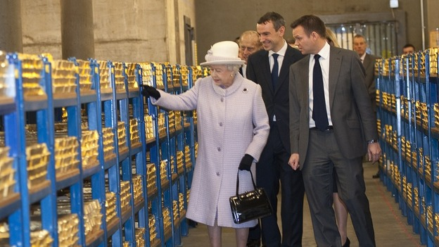 The Queen and Duke of Edinburgh were surrounded by shelves of gold during their trip to the Bank of England today