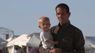 This young boy was among the civilians who fled Raqqa to makeshift desert camps.