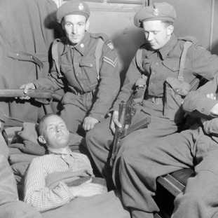 William 'Lord Haw-Haw' Joyce (on bed) in custody after the war