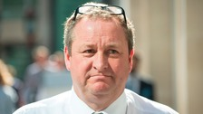 Newcastle United owner and Sports Direct boss Mike Ashley leaves the High Court in London.