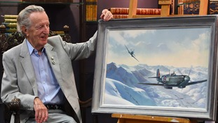 One of the last surviving Spitfire pilots Kurt Taussig, 93, looks at a painting of himself in Return from Bologna