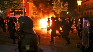 Dozens of police injured as G20 protest turns violent