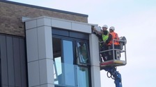 dding being removed from a high rise.