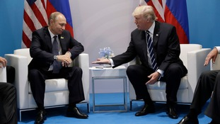 Trump questions Putin over alleged Russian meddling in US election in lengthy first meeting at G20