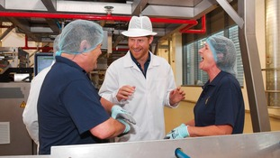 Prince HArry meets staff at the Haribo factory