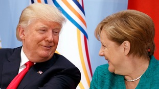 Donald Trump and Angela Merkel looked like old friends despite the US president's previous public condemnation of the German chancellor.