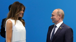 Slovenian-born Melania Trump towered over the Russian president.