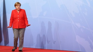 Mrs Merkel kept up the pose of the anxious host.