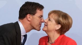Photographers had fun snapping Angela Merkel's summit greetings, suggesting she and Netherlands PM Mark Rutte rubbed noses.