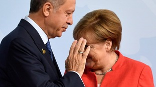 Turkey's President Recep Tayyip Erdogan appeared to give her the brush off from one angle.