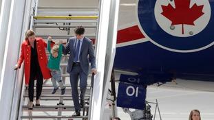 Canadian Prime Minister Justin Trudeau and his wife Sophie Gregoire-Trudeau arrived with son Hadrien.
