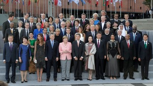 The G20 participants and their spouses posed for a 'family photo' in Hamburg.