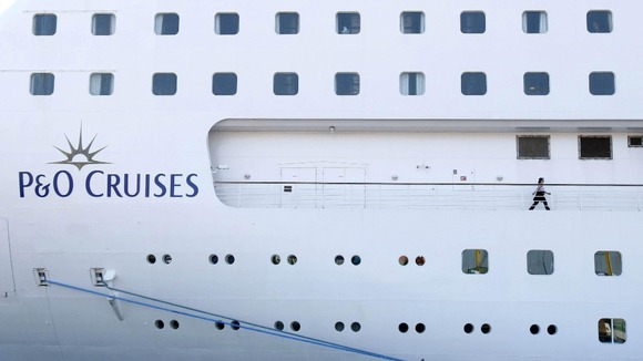 A passenger walks around the P&O cruise ship Oriana
