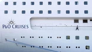 A passenger walks around the P&O cruise ship Oriana