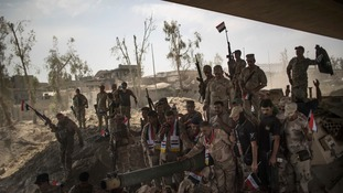 Iraqi Army soldiers celebrate win over Isis