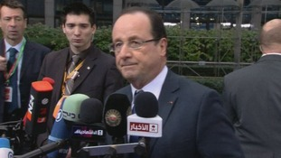 French President Francois Hollande speaking to reporters outside the EU summit