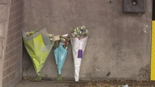 Flowers were left at the scene in memory of the men who were killed