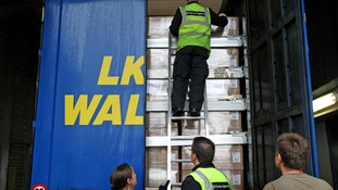 UK Border Control search a lorry trailer for stowaway passengers at Calais Ferry Port in France. Picture date: Monday June 6, 2011.