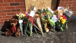 Flowers at the scene of the fire.