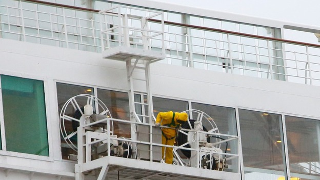 Cleaners prepare to wash the outside of the Oriana while the ship is docked in Southampton