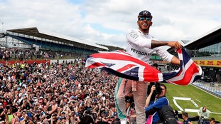 Lewis Hamilton celebrates winning the British Grand Prix.