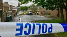 A woman was found with stab wounds at an address in Dewsbury