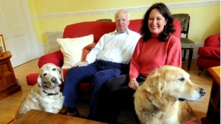 Anne Marie Morris at home with her partner Roger Kendrick and their dogs