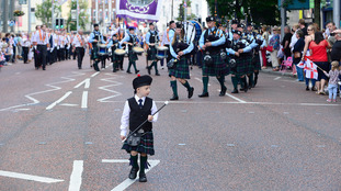 A boy takes part in a Twelfth march in Bangor.
