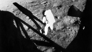 Neil Armstrong collecting the lunar sample