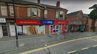 Staff threatened with gun during shop robbery