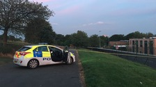 A police cordon in place in Buile Hill Park, Salford, after a man is attacked with axes.